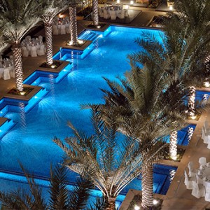 the palace downtown dubai - dubai luxury honeymoon packages - pool at night