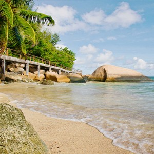 Coco de Mer & Black Parrot Suites - Luxury Seychelles Honeymoon Packages - Beach1