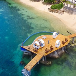 Coco de Mer & Black Parrot Suites - Luxury Seychelles Honeymoon Packages - aerial view of jetty