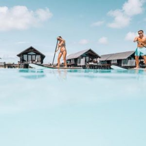 Maldives Honeymoon Packages Shangri La's Villingili Resort And Spa Standup Paddleboarding In The Lagoon