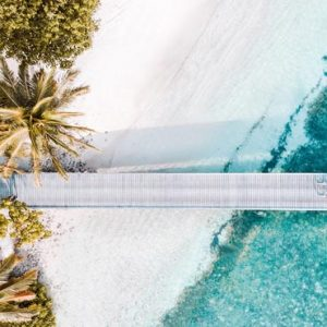 Maldives Honeymoon Packages Shangri La's Villingili Resort And Spa Couple Cycling On Jetty Aerial View