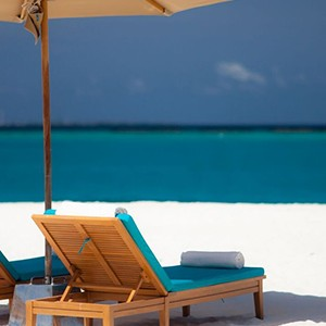 beach - The sun Sivam Iru Fushi - Luxury Maldives Honeymoons