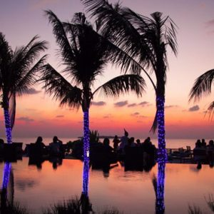 Pool Sunset Dhigufaru Island Resort Maldives Honeymoons