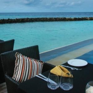 pool-side-vivanta-by-taj-coral-reef-luxury-maldives-honeymoon-packages