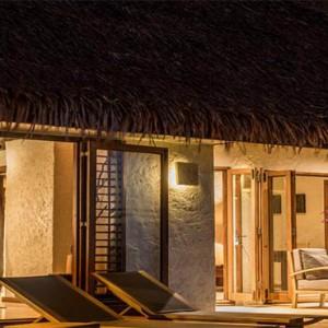 tokoriki-island-resort-fiji-honeymoon-packages-beachfront-pool-bure-exterior