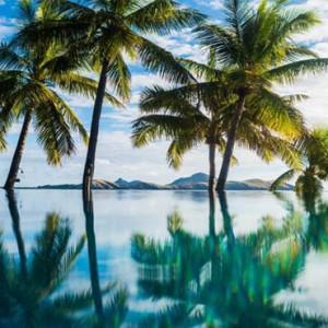 tokoriki-island-resort-fiji-honeymoon-packages-palm-trees