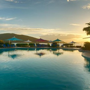 Daydream Island Resort & Spa - Australia Honeymoon Packages - pool in the sunset