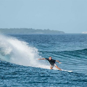 Gili Lankanfushi - Maldives Honeymoon Packages - Surfing