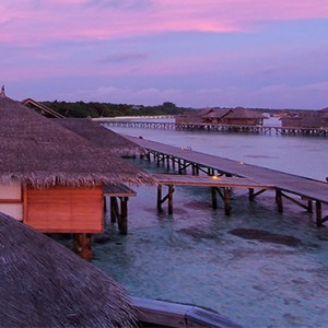 Gili Lankanfushi - Maldives Honeymoon Packages - Villa Suite at sunset