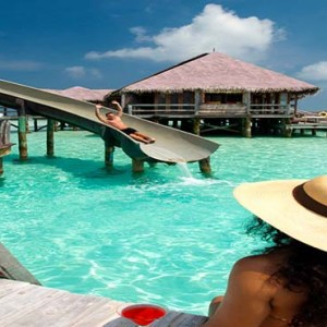 Gili Lankanfushi - Maldives Honeymoon Packages - slide by pool