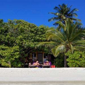 Komandoo Island Resort - Maldives honeymoon packages - Beach villa beach