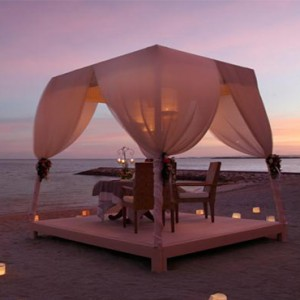 Puri Santrian - Bali Honeymoon Packages - beach candlelit dining