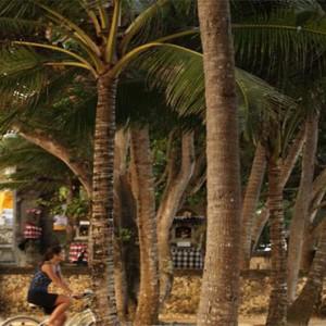 Puri Santrian - Bali Honeymoon Packages - bike stroll