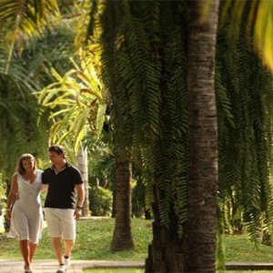 Puri Santrian - Bali Honeymoon Packages - garden stroll