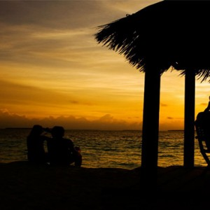 Reethi Beach Resort - Maldives Honeymoon Packages - Beach bar at sunset