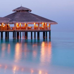Reethi Beach Resort - Maldives Honeymoon Packages - moodhu bar at sunset