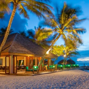 Veligandu Island Resort & Spa - Maldives Honeymoon Packages - Athiri Bar Exterior at Evening