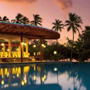 Dreams La Romana Resort & Spa - Dominican Republic luxury Honeymoon packages - infinity pool at night