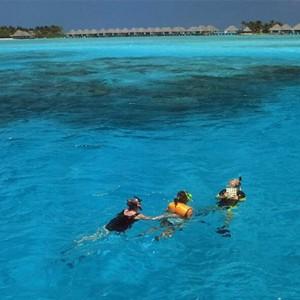 Four Seasons Resort Maldives at Kuda Huraa - Maldives Honeymoon Packages - Snorkeling