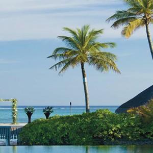 Four Seasons Resort Maldives at Kuda Huraa - Maldives Honeymoon Packages - Wedding ceremony at pool island