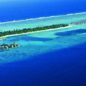 Four Seasons Resort Maldives at Kuda Huraa - Maldives Honeymoon Packages - aerial view