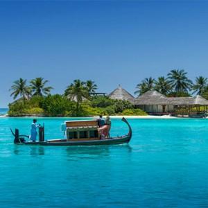 Four Seasons Resort Maldives at Kuda Huraa - Maldives Honeymoon Packages - dhoni to island spa