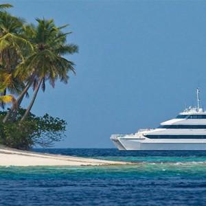 Four Seasons Resort Maldives at Kuda Huraa - Maldives Honeymoon Packages - four seasons explorer