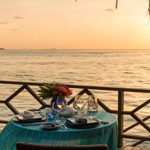 Four Seasons Resort Maldives at Kuda Huraa - Maldives Honeymoon Packages - in bungalow romantic dining