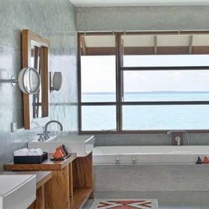 Four Seasons Resorts at Landaa Giraavaru - Maldives Luxury Honeymoon Packages - Sunset Water Villa with Pool bathroom