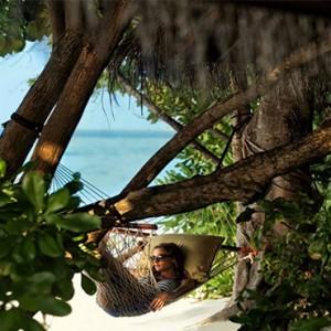 Four Seasons Resorts at Landaa Giraavaru - Maldives Luxury Honeymoon Packages - hammock on beach