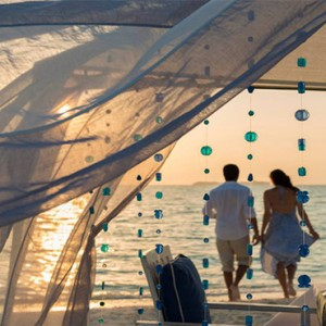 Four Seasons Resorts at Landaa Giraavaru - Maldives Luxury Honeymoon Packages - romantic stroll