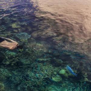 Four Seasons Resorts at Landaa Giraavaru - Maldives Luxury Honeymoon Packages - snorkelling