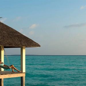 Four Seasons Resorts at Landaa Giraavaru - Maldives Luxury Honeymoon Packages - swing deck