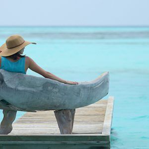Maldives Honeymoon Packages Gili Lankanfushi Woman Relaxing On Deck