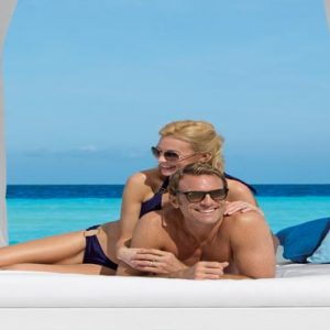 Mexico Honeymoon Packages Dreams Sands Cancun Resort And Spa Couple On Daybed