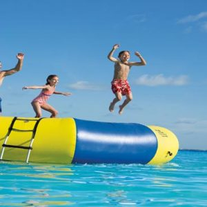 Mexico Honeymoon Packages Dreams Sands Cancun Resort And Spa Kids On Trampoline