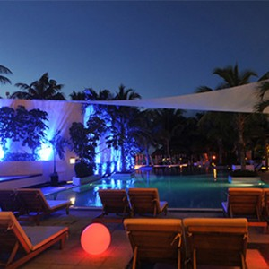 pool at night - Dreams Sands Cancun Resort & Spa - Mexico Luxury honeymoon packages
