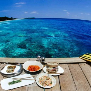 Amilla Fushi - Maldives Honeymoon packages - meal on deck