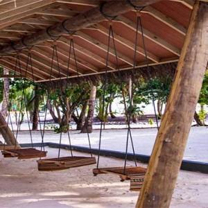 Amilla Fushi - Maldives Honeymoon packages - swings on beach