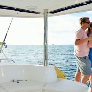 Eden Bleu Hotel - Luxury Seychelles Honeymoon packages - couple on yacht