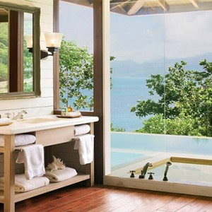 Four Seasons Resort Seychelles - Luxury Seychelles Honeymoon packages - Hilltop ocean view villa bathroom