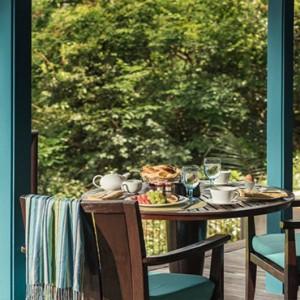 Four Seasons Resort Seychelles - Luxury Seychelles Honeymoon packages - Ocean view villa deck table