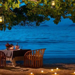 Four Seasons Resort Seychelles - Luxury Seychelles Honeymoon packages - Romantic beach dinner