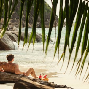 Four Seasons Resort Seychelles - Luxury Seychelles Honeymoon packages - couple on beach