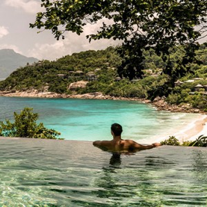 Four Seasons Resort Seychelles - Luxury Seychelles Honeymoon packages - man in pool