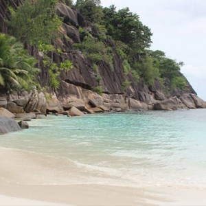 Four Seasons Resort Seychelles - Luxury Seychelles Honeymoon packages - man strolling on beach