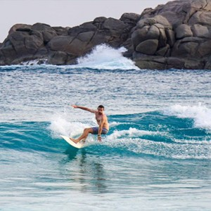 Four Seasons Resort Seychelles - Luxury Seychelles Honeymoon packages - surfing