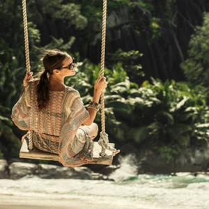 Four Seasons Resort Seychelles - Luxury Seychelles Honeymoon packages - swing on beach