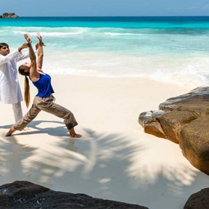 Four Seasons Resort Seychelles - Luxury Seychelles Honeymoon packages - yoga on beach1