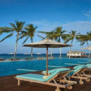 Loama Resort Maldives at Maamigili - Luxury Maldives Honeymoon packages - Day bed by pool
